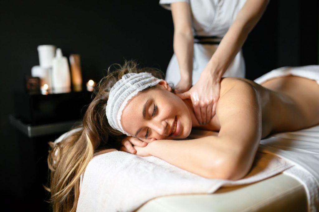 woman getting a massage in dark room