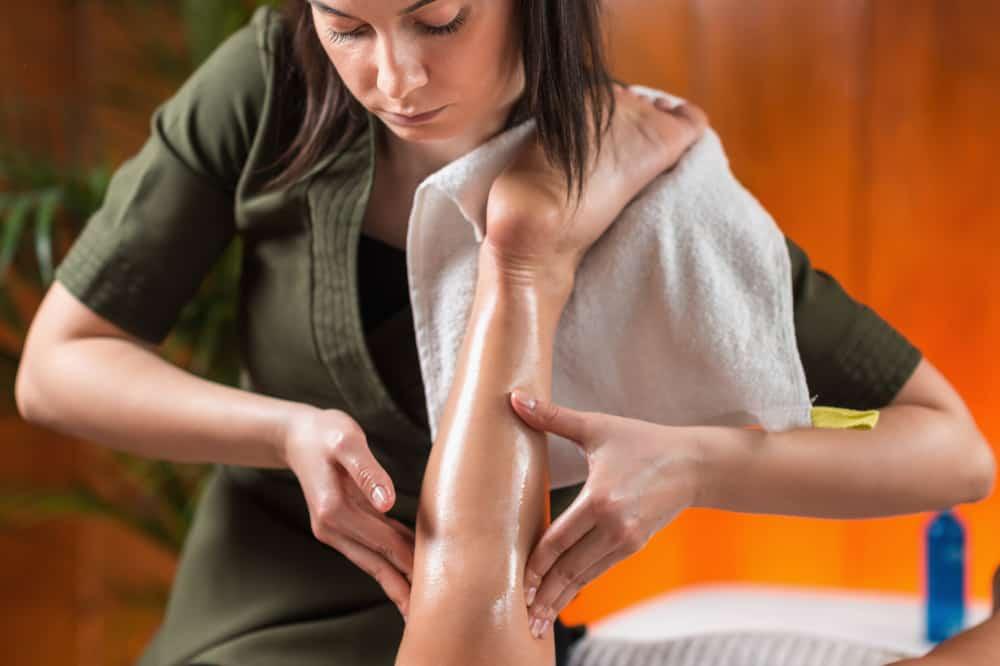 sports massage on calf muscle