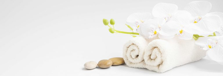 spa compliments towel and stones